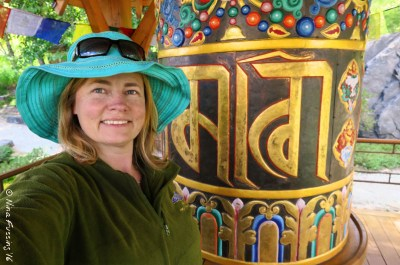 Moi at the Tibetan Prayer Wheel in the Sawtooth Botanical Gardens