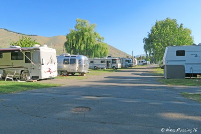 """View from far end of RV park. Site #25 on right is a prime """"end site"""" with no-one next to them."""