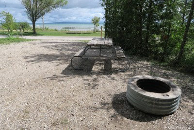 """Typical """"sitting area"""" with picnic table and firepit. This is one of the water-view sites in section S, #183"""