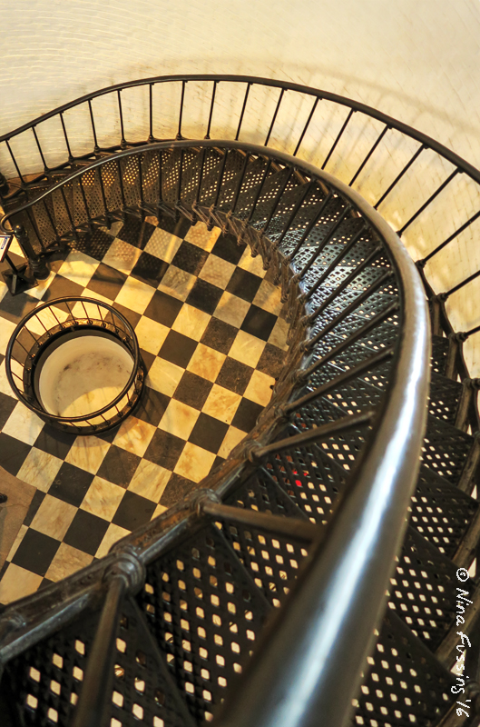 View down the staircase and marbled floors