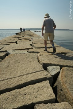 Dad walking the breakwater