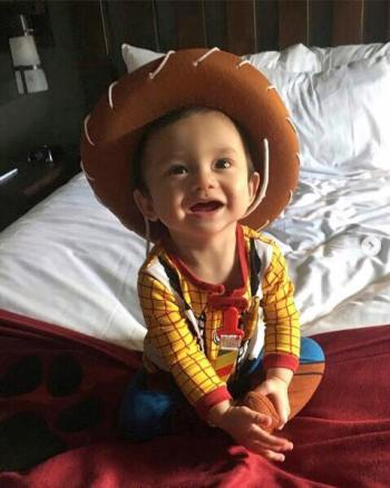baby in Woody toy story costume