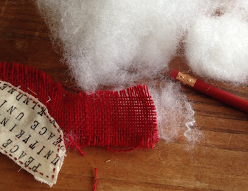 Gently stuff cardinal with fiber fill. Use Fabri-Tac to seal end of tail when finished stuffing.