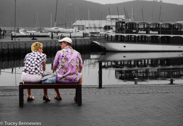 Tourists enjoying a break at the harbour.