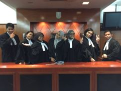 Prosecution team with the 'Judge'