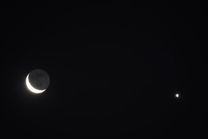 2020, July 17: The crescent moon appears near Venus before sunrise. The night portion of the moon is gently illuminated by earthshine.