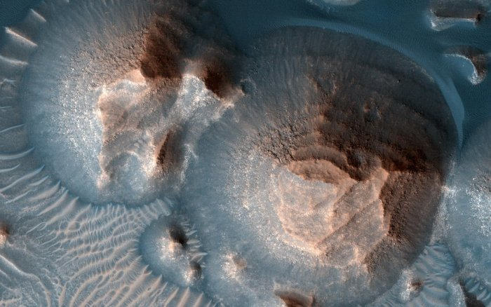 This image shows several craters in Arabia Terra that are filled with layered rock, often exposed in rounded mounds. The image was taken by a camera, the High Resolution Imaging Experiment, on NASA's Mars Reconnaissance Orbiter. Credit: NASA/JPL-Caltech/University of Arizona
