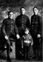 A photograph from the Aberdare Leader of 24 July 1915 of three boys of the 5th Welsh then stationed at Bedford but taken during their earlier posting at Burntisland, Fifeshire - they are Bugler Gwilym John Lloyd, left; Lance-Corporal Hamments, centre; Private E Goddard, right. The little chap was a regimental pet during their stay in Burntisland.