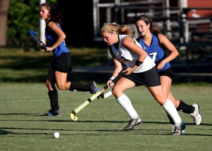 Women playing on a field hockey team