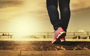 Woman walks outdoors as one of the stress reduction techniques that works for her