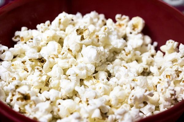 Popcorn is one of the healthy snacks for a road trip with kids.