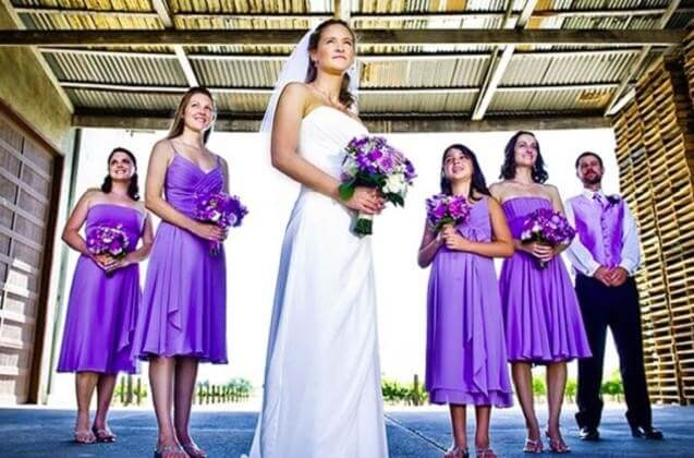 Bridesmen can wear a suit matching the lavender bridesmaids' dresses