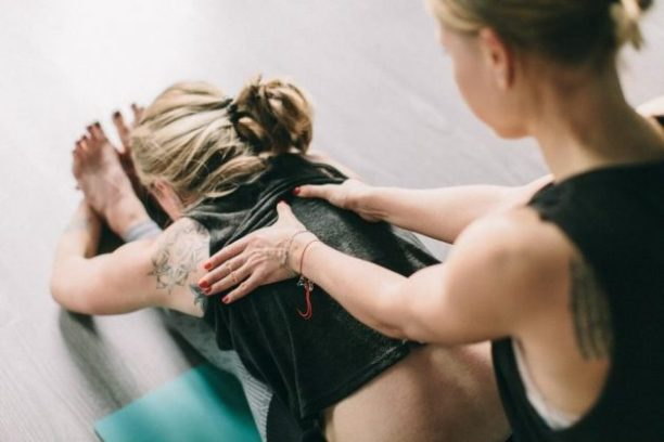 Woman stretches; she gets injury rehab at home