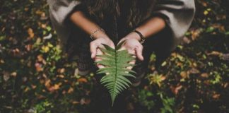 She holds leaf, supporting eco-friendly activewear brands