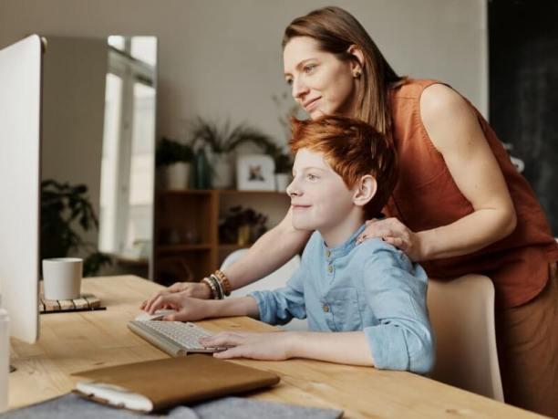 Mom teaching complex topics to son