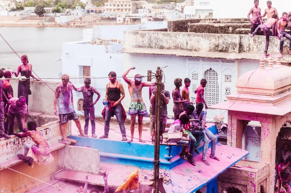 Locals and Tourists Dancing On Roof During Holi In Pushkar India
