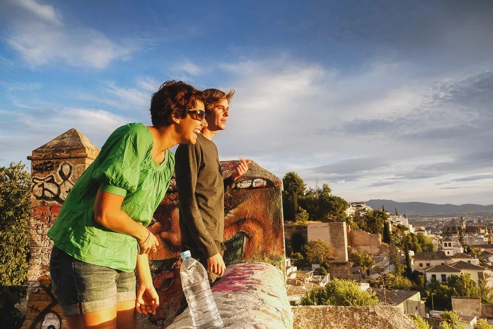 Friends watching the sunset in Granada, Spain