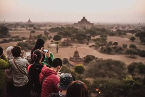 Tourists on top of pagodas at dawn in Bagan