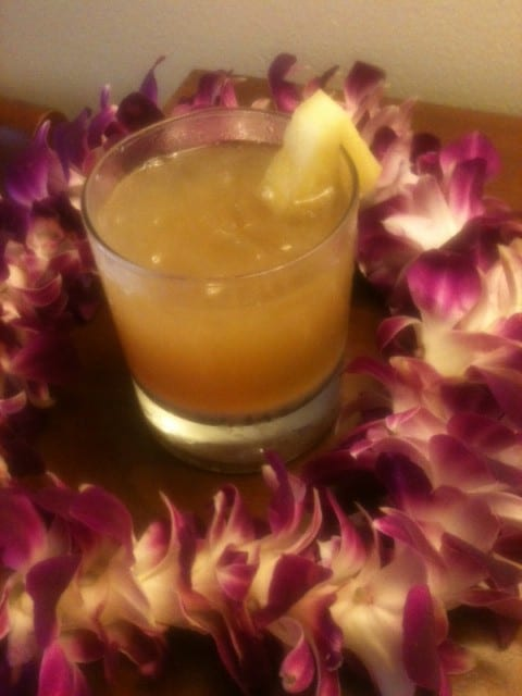 A stirred Mai Tai and fresh orchid Lei, both hand crafted by Brenda C Hill on Kauai.
