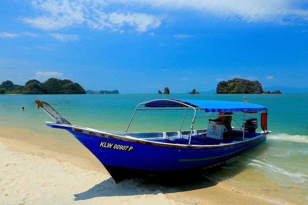 Boat-on-Langkawi-beach-Malaysia