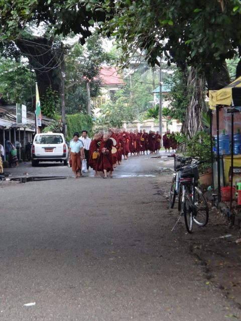 A common site here in Burma, monk heading out on daily alms.