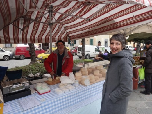 Buying cheese at an open market we stumbled upon. No English. No real tourist here.