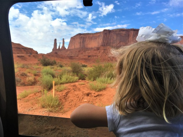 Driving along the rough 17-mile loop road through Monument Valley Tribal Park.
