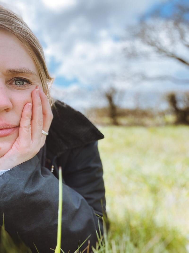 image of girl lying in a field