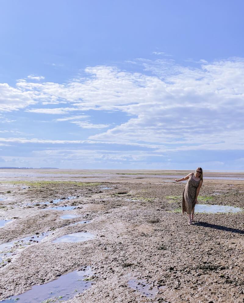 image of a women standing on Stiffkey mud flats