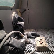 metal bows inside sandblaster
