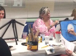 woman painting at the senior center