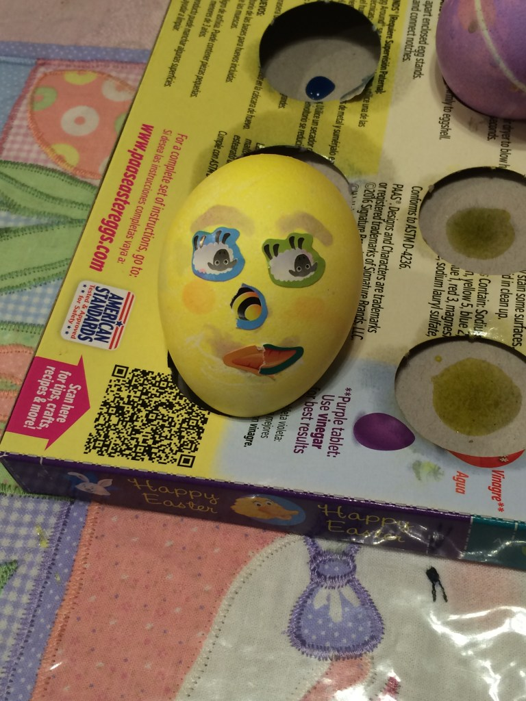 colored Easter egg with a face on it