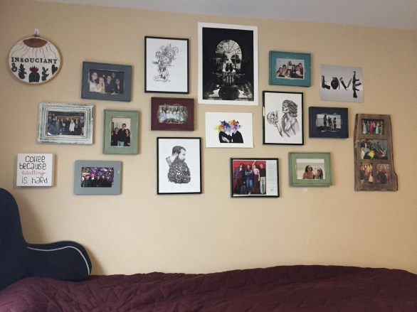 Posters and photos hanging on wall