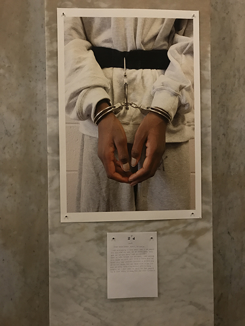Photo of Ross's work, a child in handcuffs