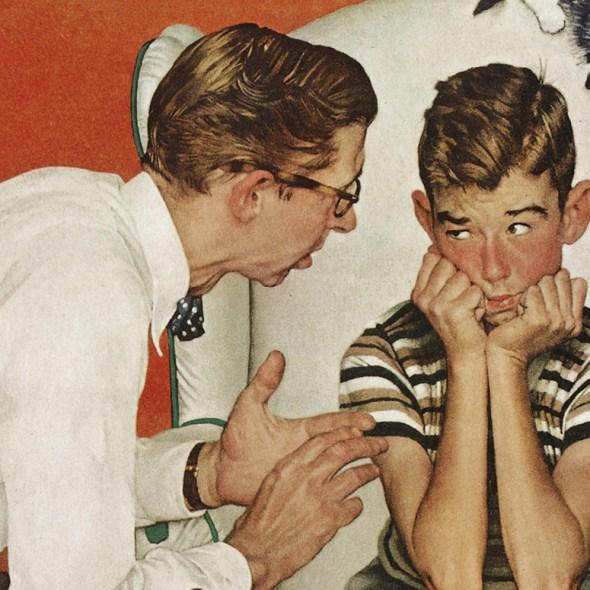 A man talking to a boy