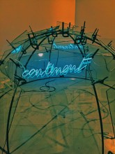 neon word continent sculpture