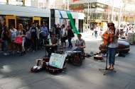 Buskers and trams, epitomizing Melbourne