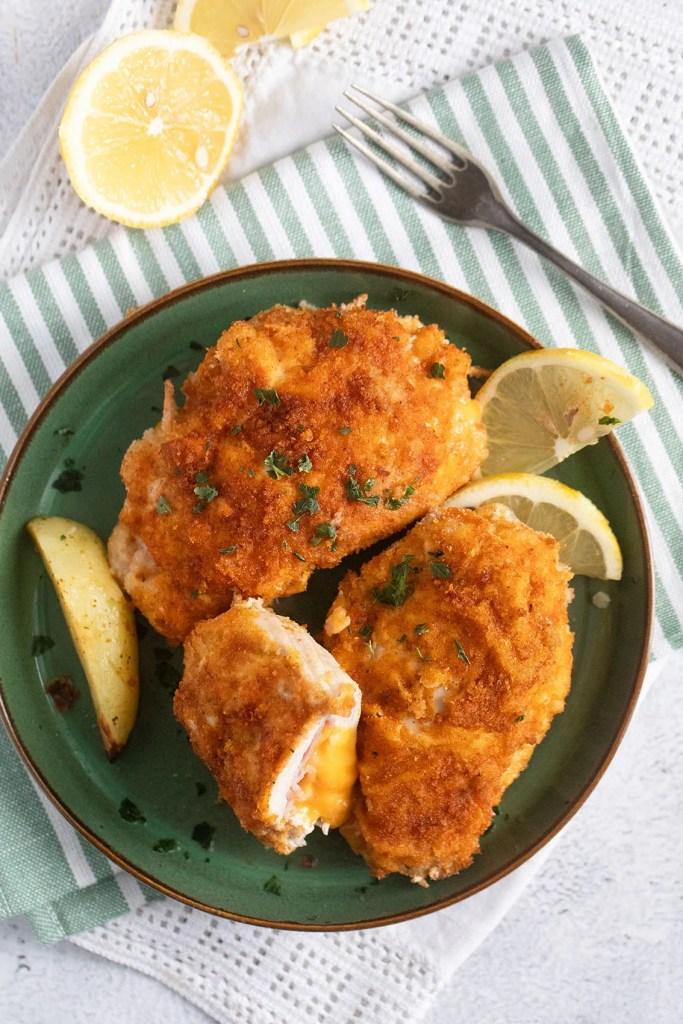 chicken schnitzel baked 683x1024 Crispy Chicken Schnitzel with Ham and Cheese