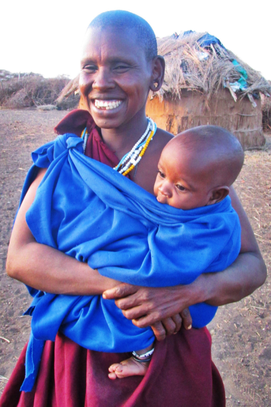 A Maasai woman and her child at her boma near Moshi, Tanzania
