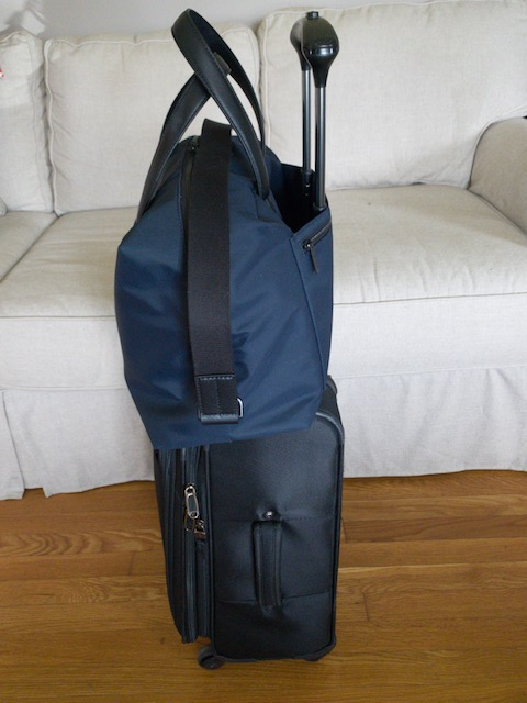 Away Everywhere bag sitting on black suitcase