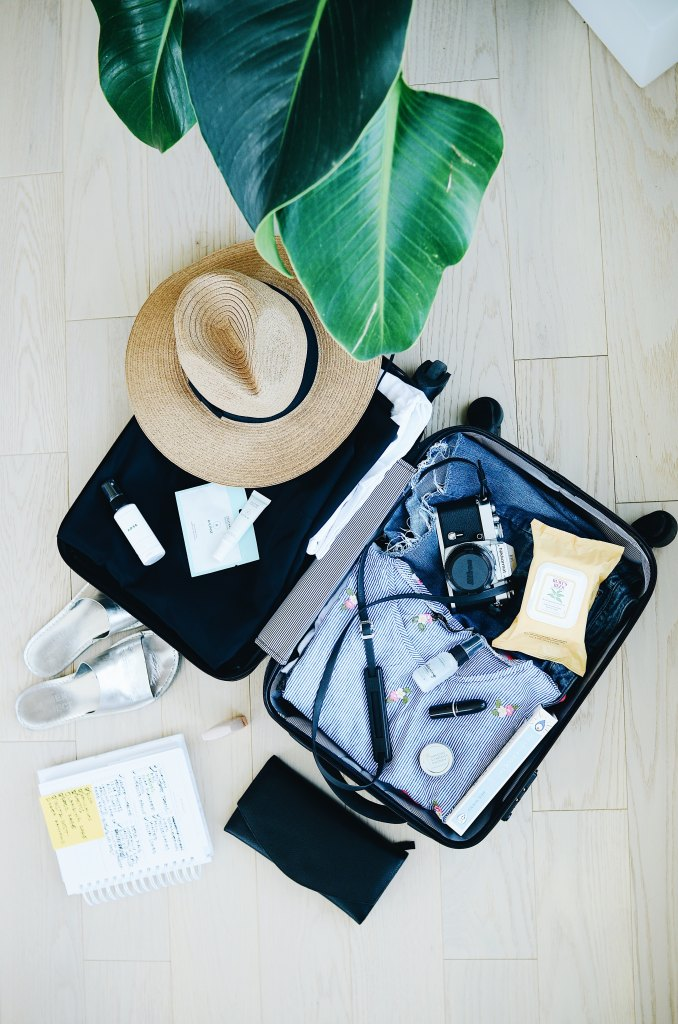 suitcase and packing list list preparing for a first time flight experience