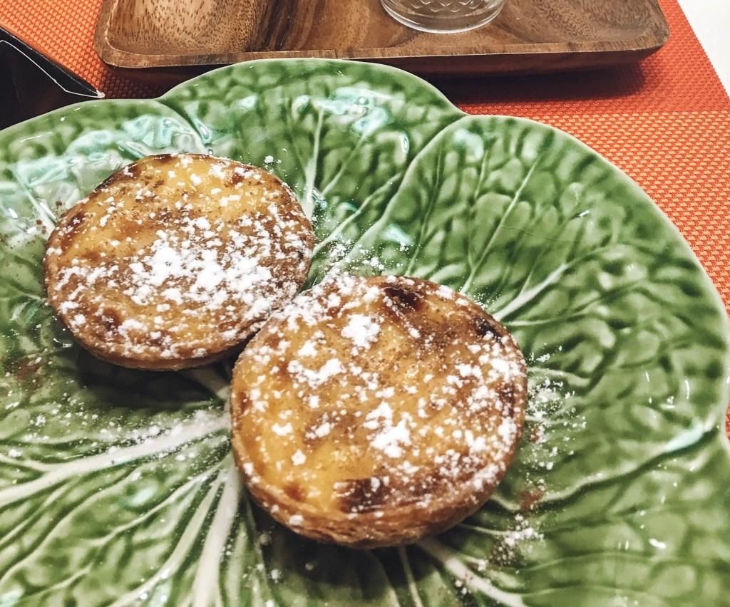 green platter with warm Pasteis de Nata