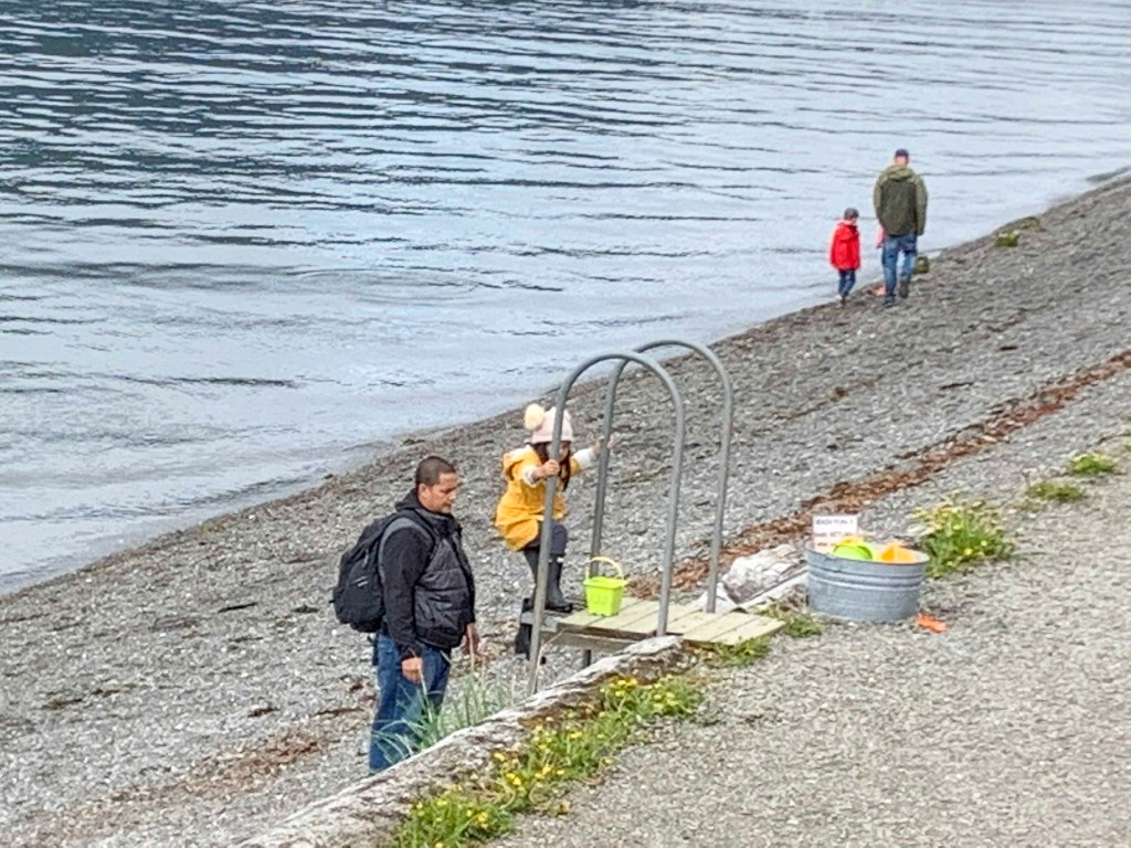 families playing on the beach in Icy Strait Point, Alaska