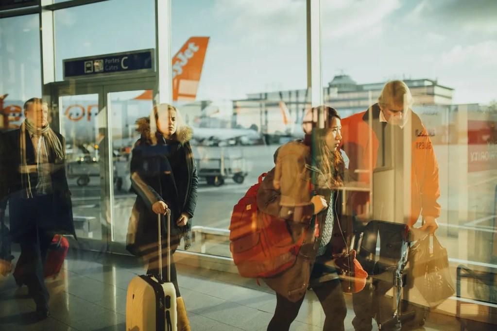 travelers walking through airport