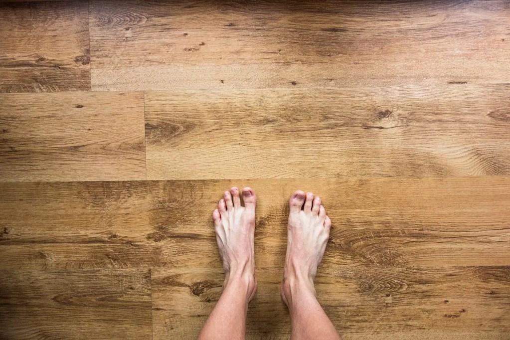 bare feet on a wooden floor