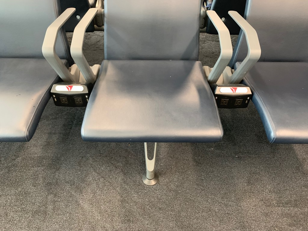 seats with electric outlets at airport in Atlanta