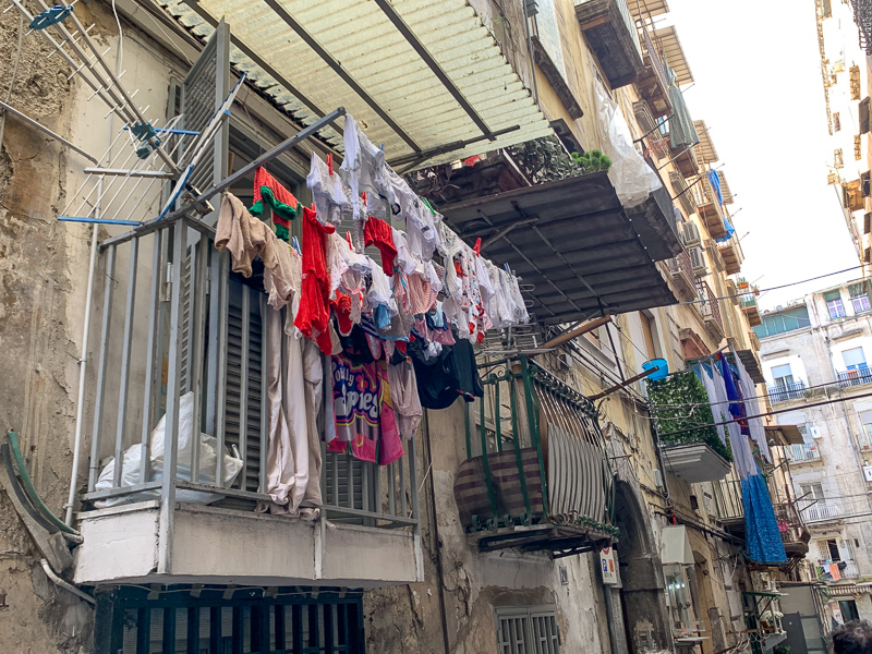laundry hanging out side window in Naples