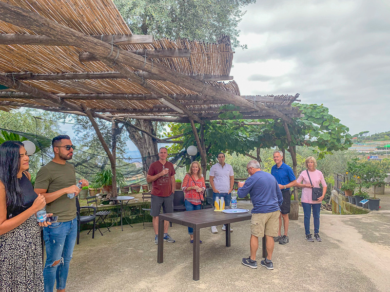 Group of people waiting for a tour to start at La Masseria farm just outside of Sorrento.