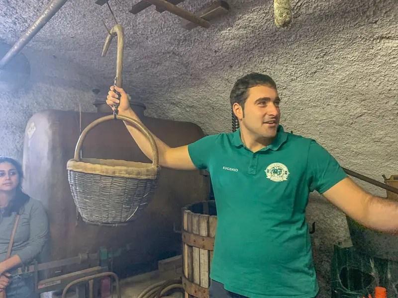 Man leading farm tour in Sorrento, Italy.