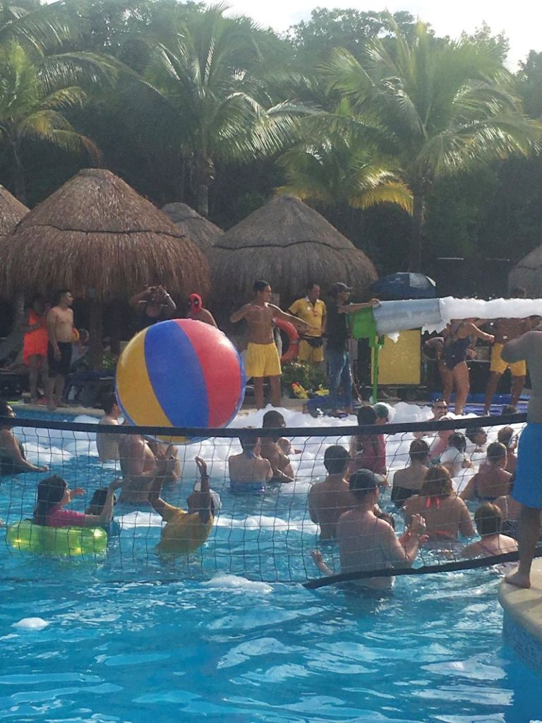 Foam pool party at all-inclusive vacation in Mexico.